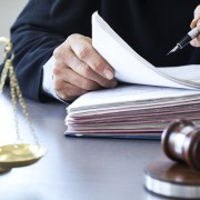 Scales of justice with judge gavel on table